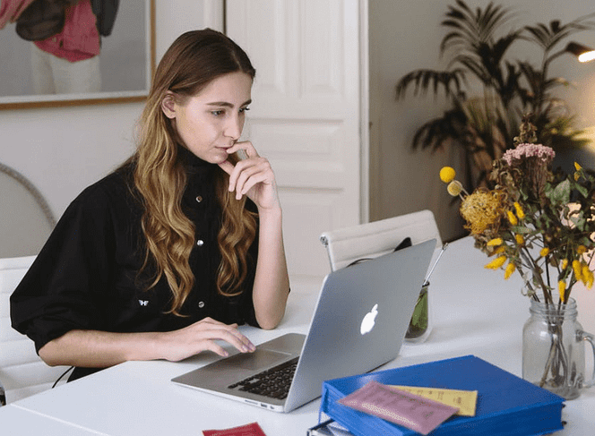 woman deeply staring at her macbook